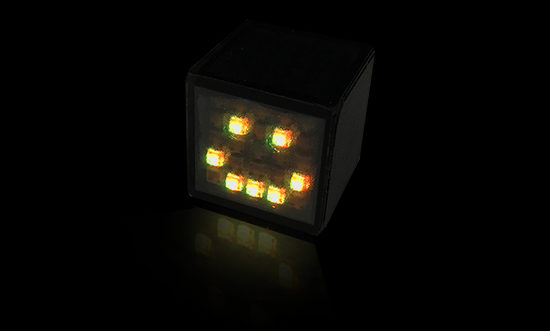 Dicees. Custom die with a yellow smiley draw thank to the RGB LEDs